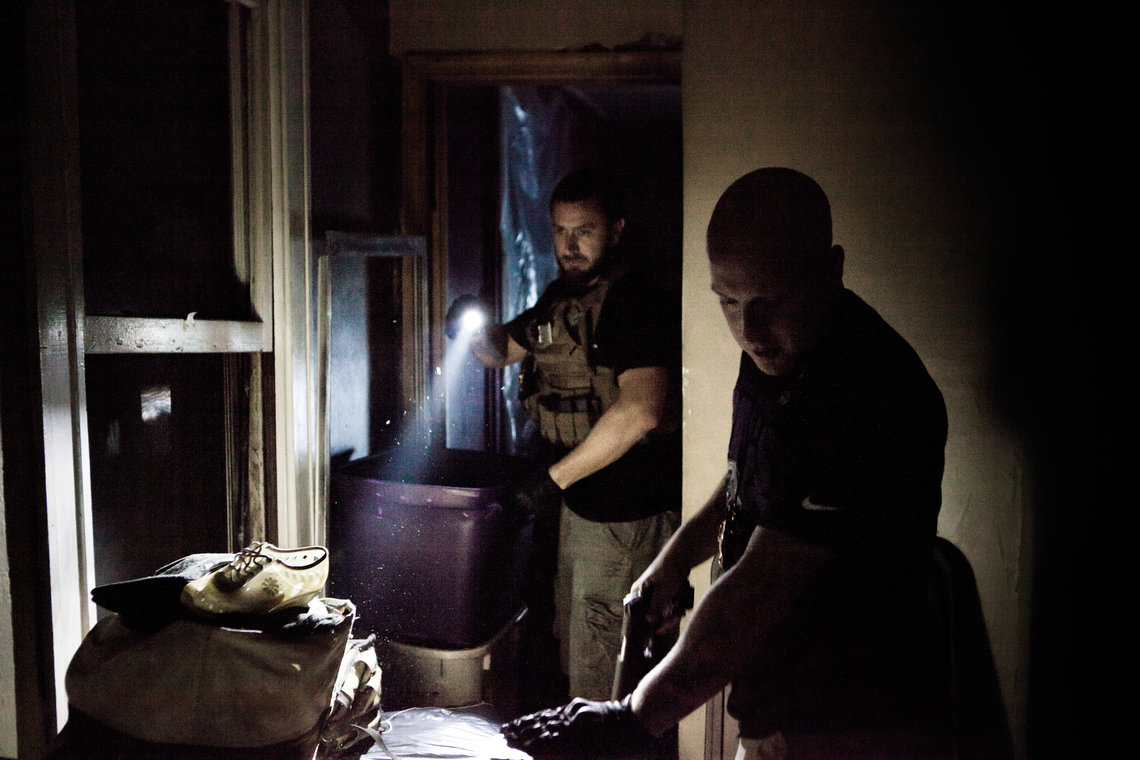 Bondsmen enter a defendant's home in the Bronx.