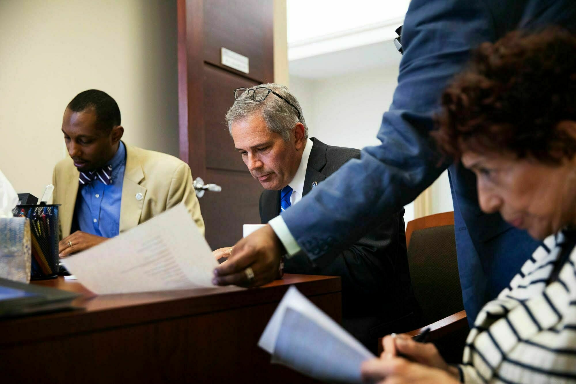 """A still from the documentary, """"Philly D.A."""", of Philadelphia District Attorney, Larry Krasner, with his team."""