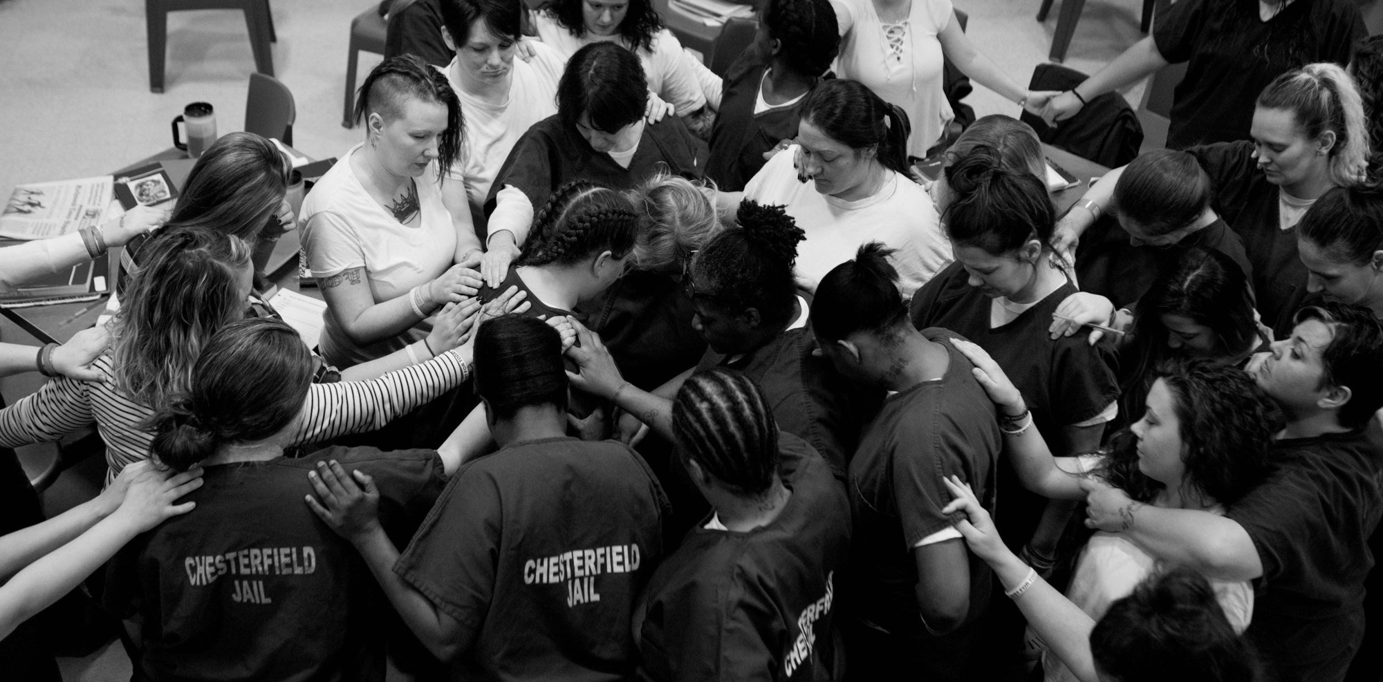 Members of the Heroin Addiction Recovery Program at the Chesterfield County Jail in Virginia pray for a participant as she was preparing to be released in November of 2017.