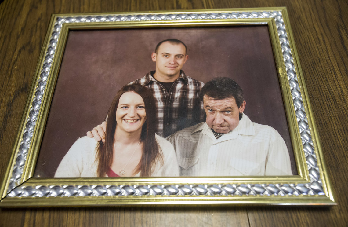 A family photo shows Nicholas Glisson, right, with his grown children, before he was sentenced to prison.