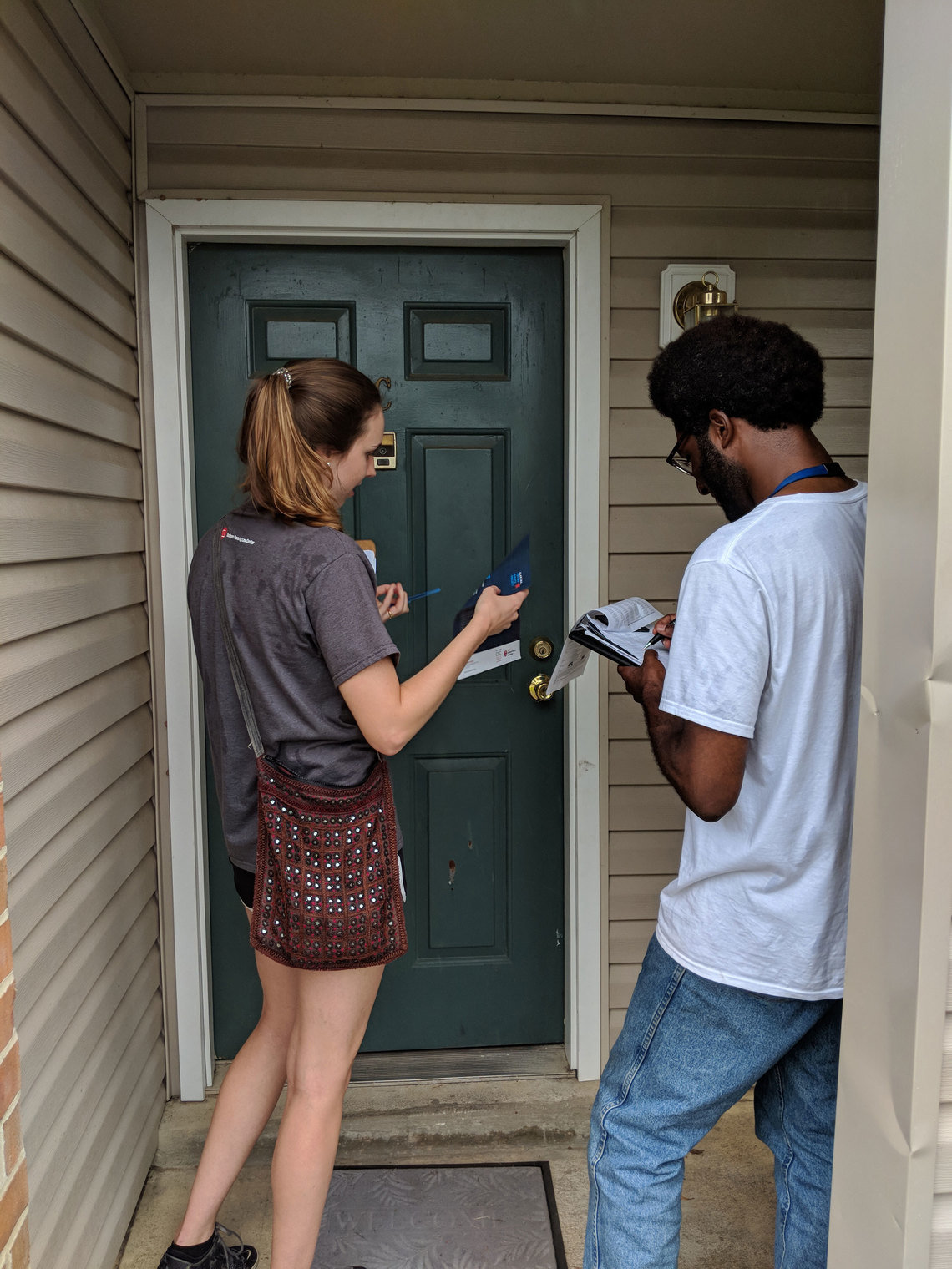 Sean Champagne and Ellen Boettcher, Alabama Voting Rights Project fellows, canvassing in Montgomery in August 2018.  They told residents about the change in the Alabama law that allows many people with convictions who previously could not vote to get registered.