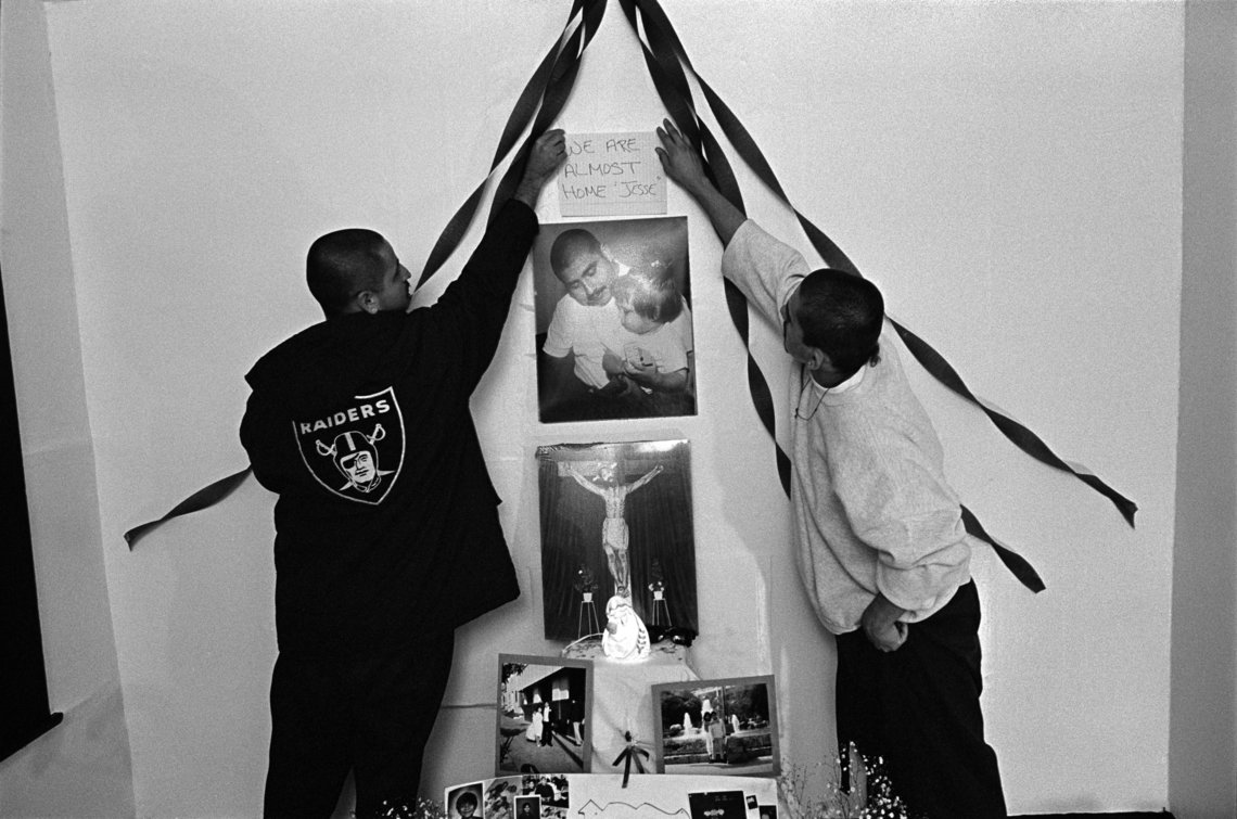 Members from the Evergreen gang make an altar for one of their fallen. (Los Angeles, 1993)