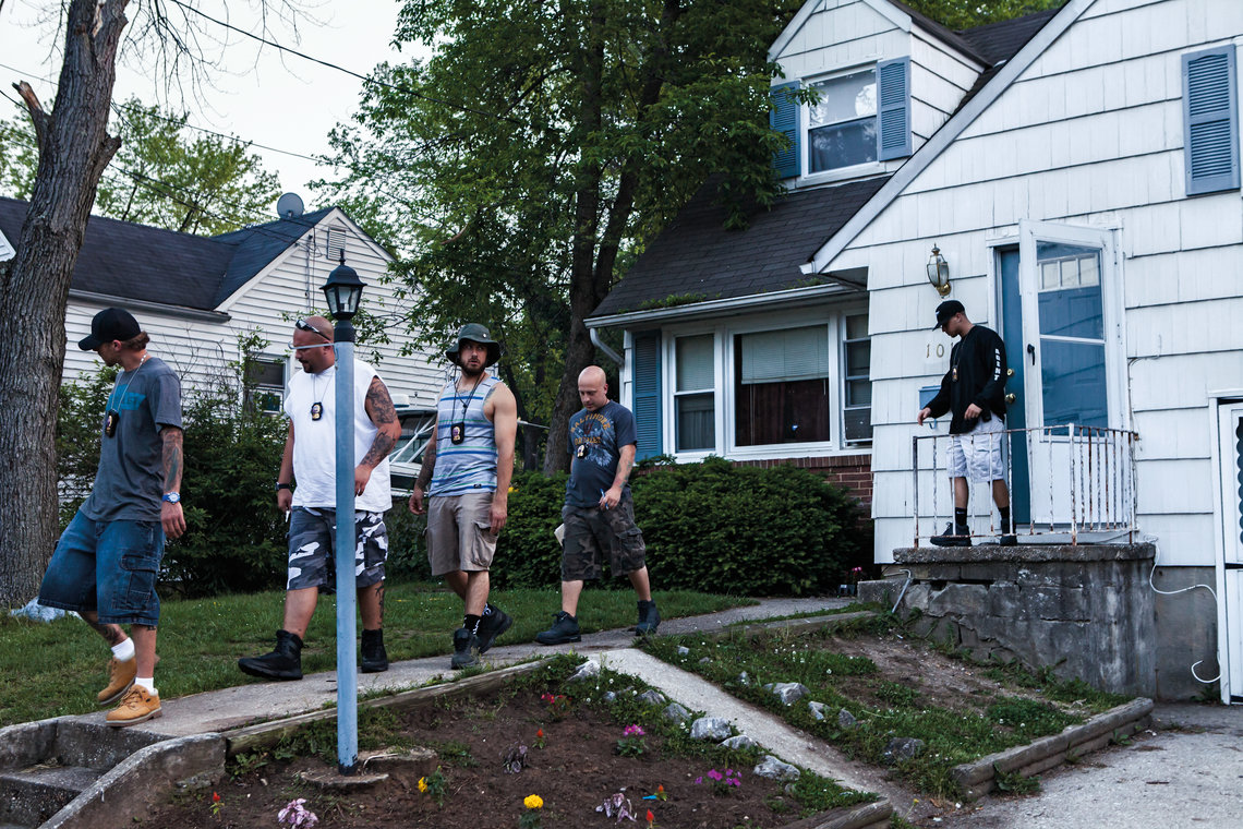 Bounty hunters leave the house of a fugitive's relative in Baltimore County, Md.