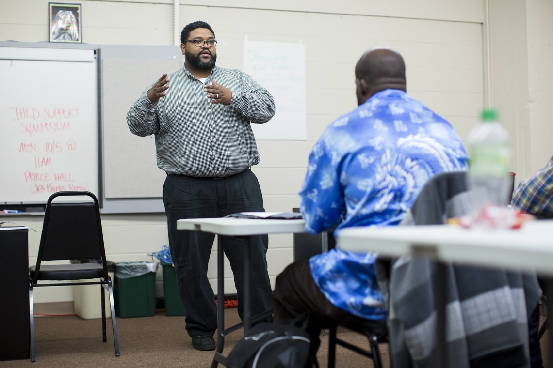 Tessie Amos III, a group facilitator, speaks to men during a Fathers' Support Center session on Sept. 30, 2015 in Wellston, Mo.
