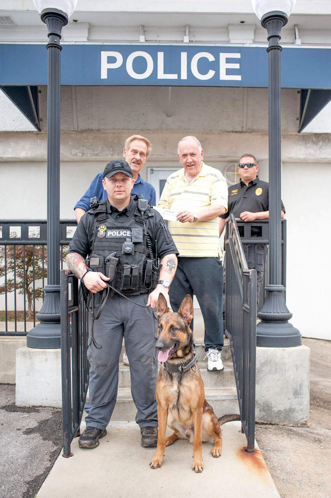 Officer Daniel Chesser, front, with his police dog, Andor, in Talladega, Alabama, in 2015.
