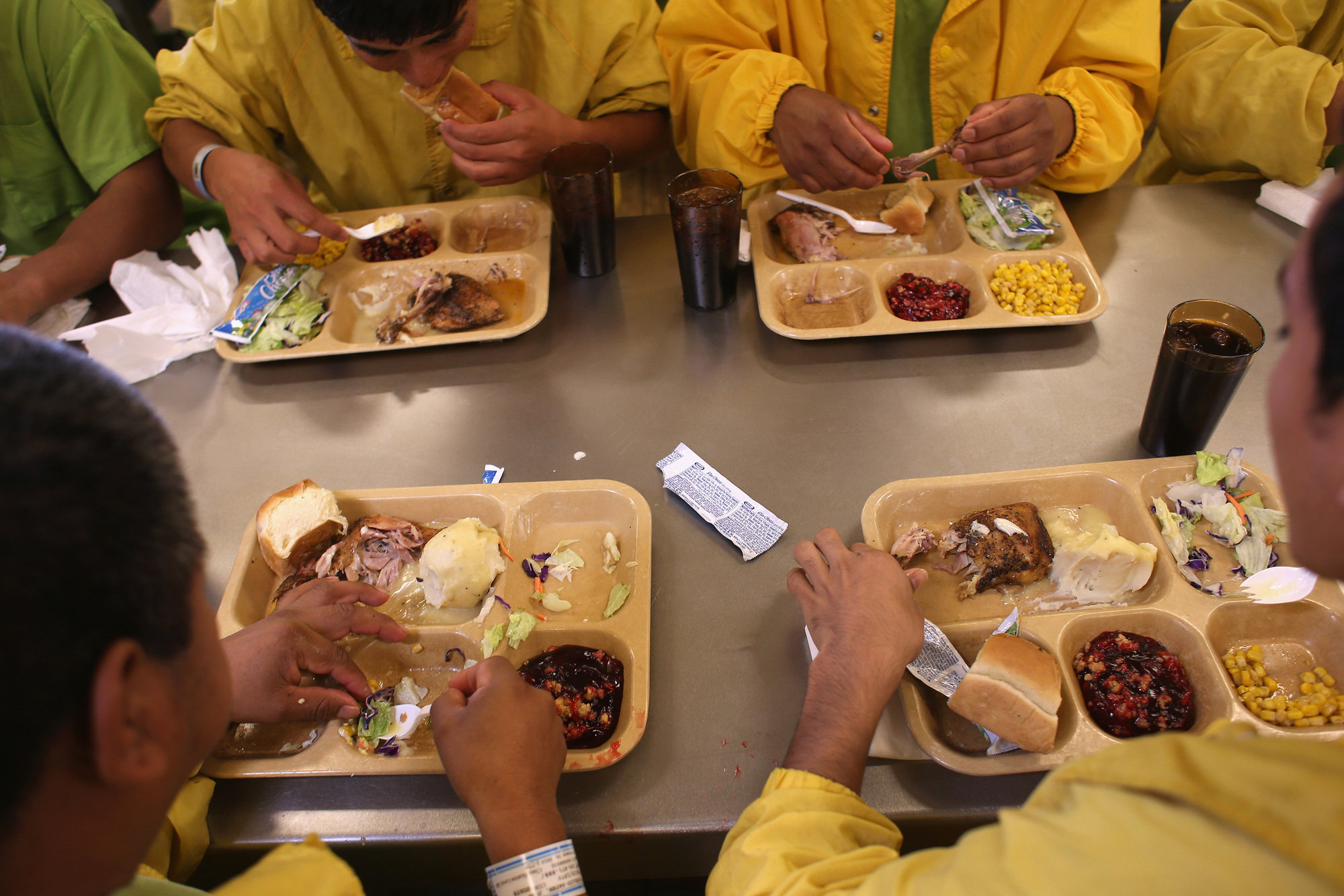 Detainees eat lunch at the Immigration and Customs Enforcement detention facility in Florence, Ariz., on Feb. 28, 2013.