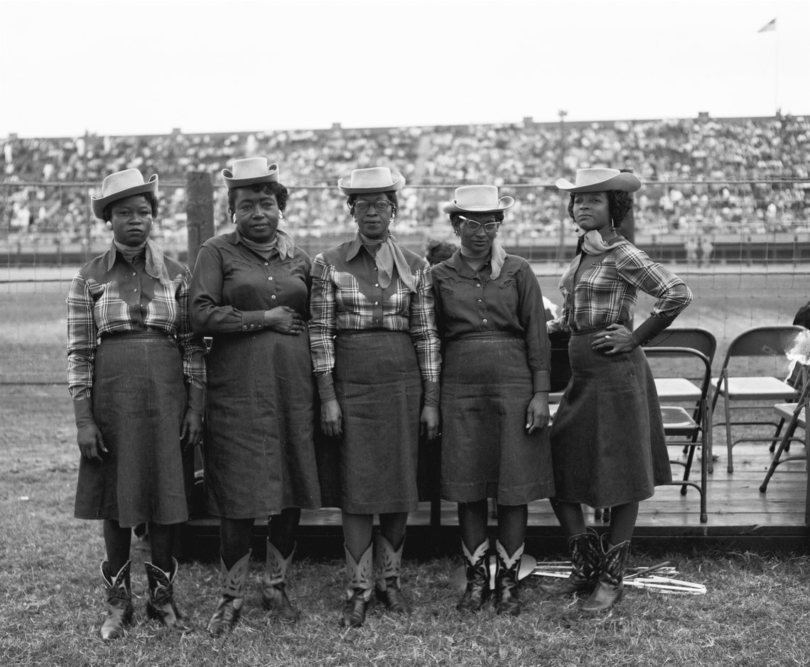 Members of an African American musical group from Goree strike poses in their full Western dress.
