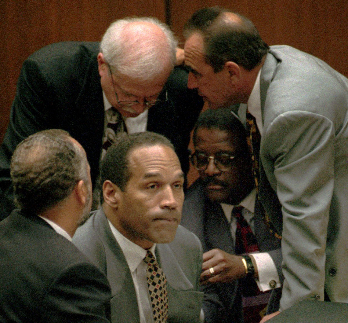 O.J. Simpson surrounded by his attorneys, clockwise from left, Ken Spaulding, Gerald Uelmen, Robert Shapiro and Johnnie Cochran Jr., during his double-murder trial in Los Angeles in 1995.