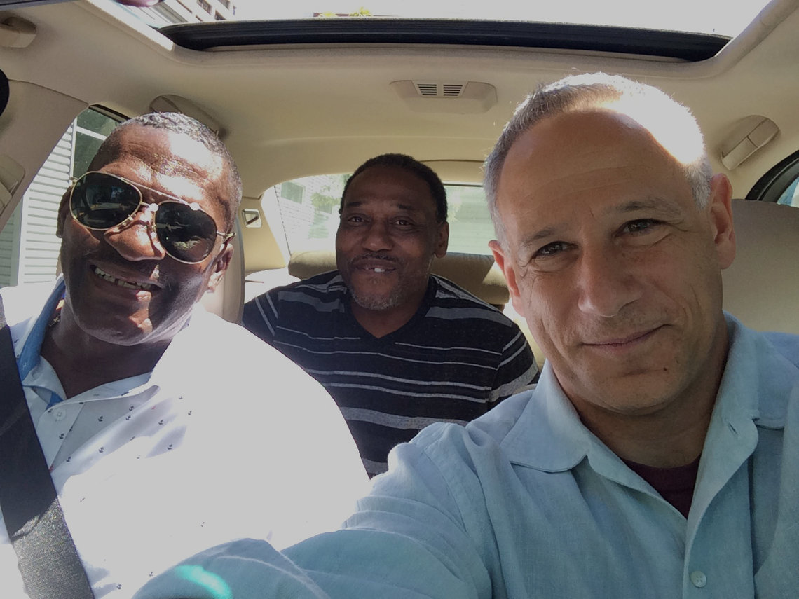 Jon Eldan, right, with After Innocence clients Willie Green, left, and Danny Brown, in June 2016.