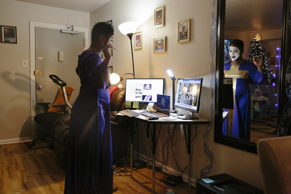 G. King mimes in front of computer monitors in her home on Dec. 17, 2020 for an event with women who are returning from prison. After turning to miming as a tool to express herself and heal in prison, King now uses miming as a form of ministry and connectivity at events and in her church in Washington, D.C.