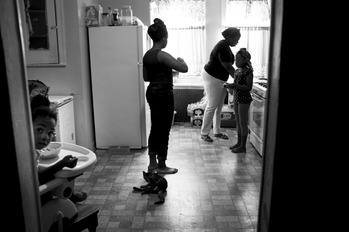 Keisha Boone makes breakfast for the six children she looks after on Aug. 10, 2013. Keisha is one of many single mothers living in Camden. Her first husband was shot and killed, and the father of her youngest child is in jail.