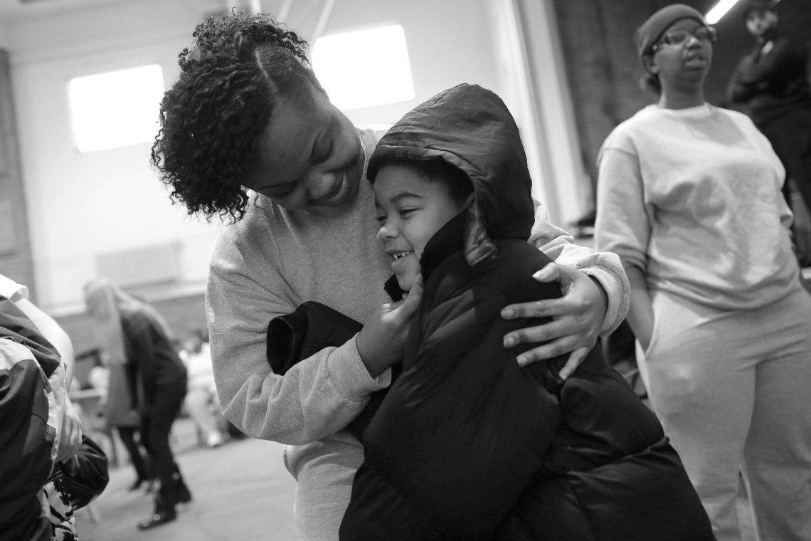 Lakeisha, an inmate at the Logan Correctional Center, hugs her son, Jayden, as he arrives for a visit. More than 100 children and caregivers were brought to see their mothers.