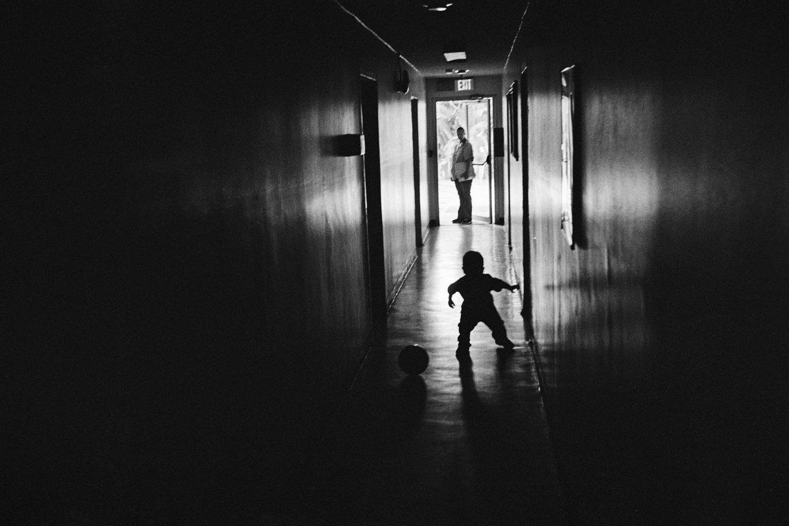 A boy plays in the hallway at Walden House.  (El Monte, 2008)