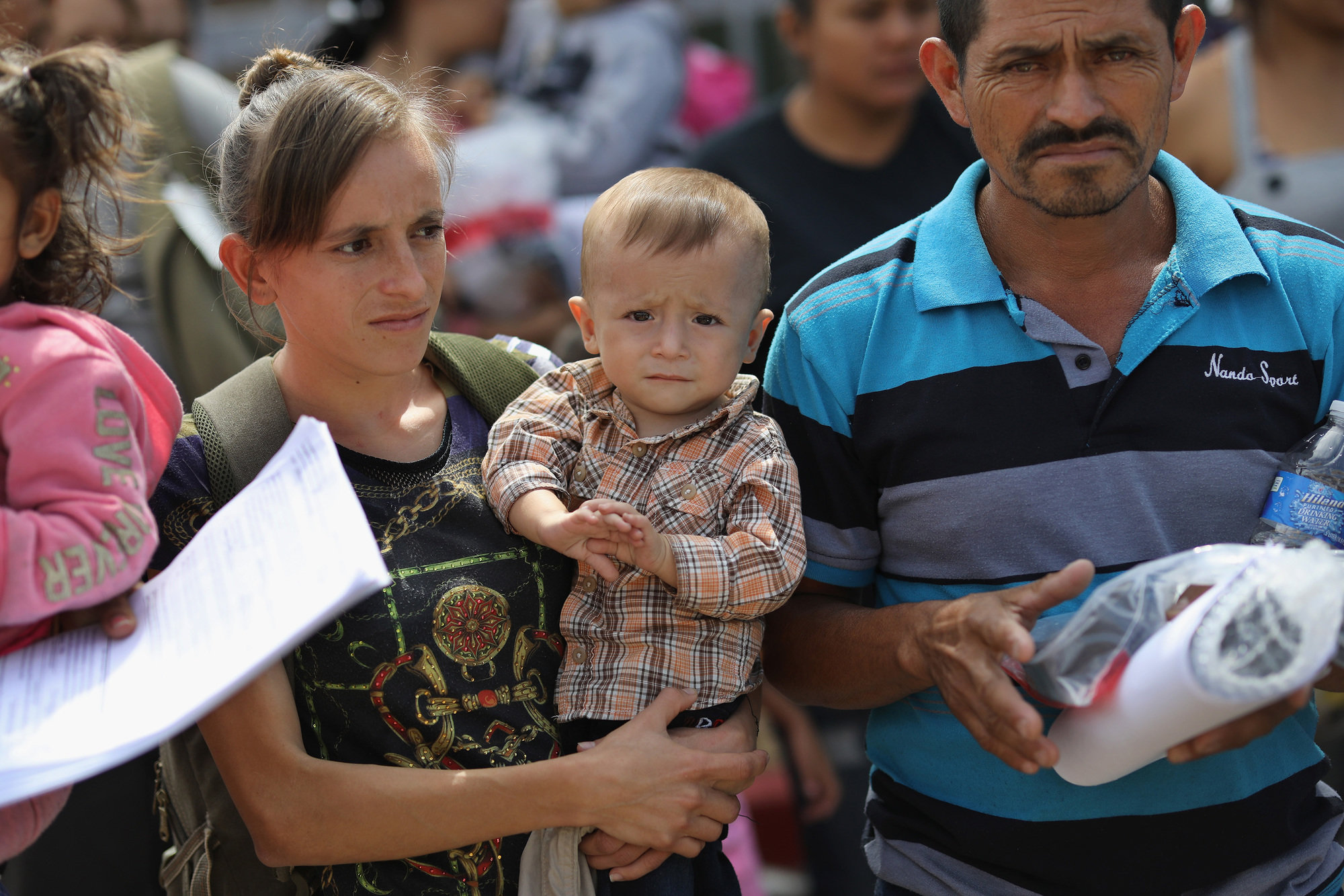 Migrant families from Central America are released at the border with orders to appear for future hearings in immigration court, on June 11, 2018 in McAllen, Texas.