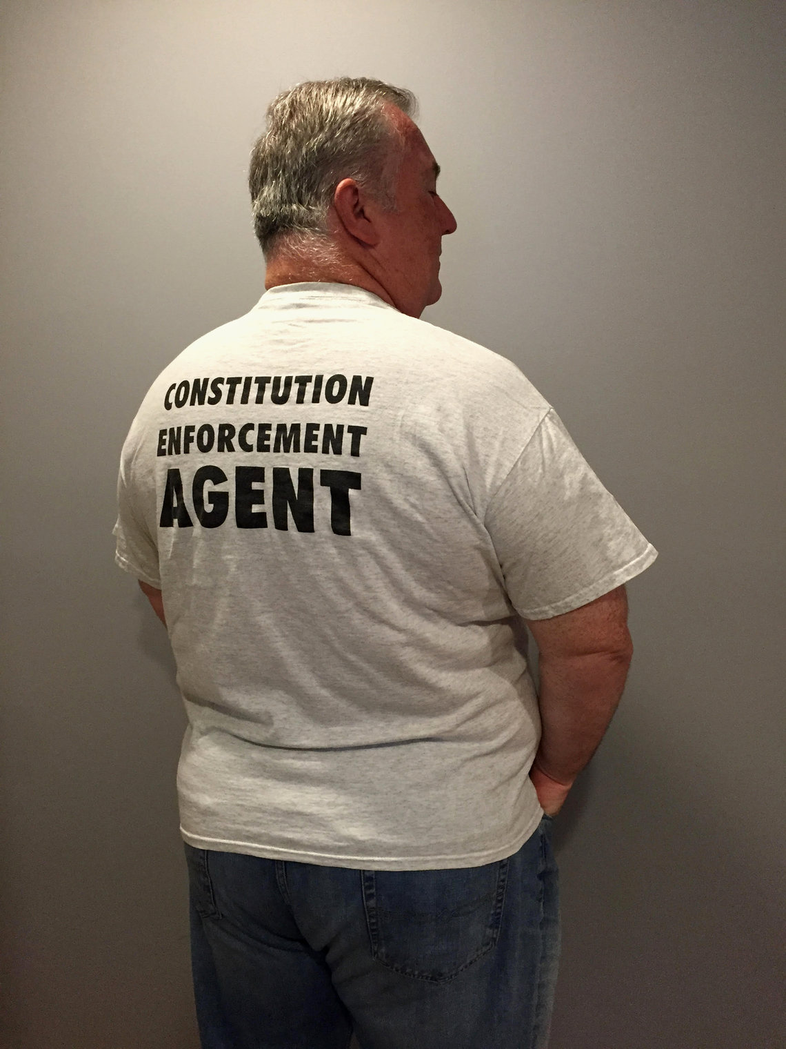Lawyer Jay Ruane, above, wears this shirt to his local music festival, where he answers questions about the law and promotes his firm.