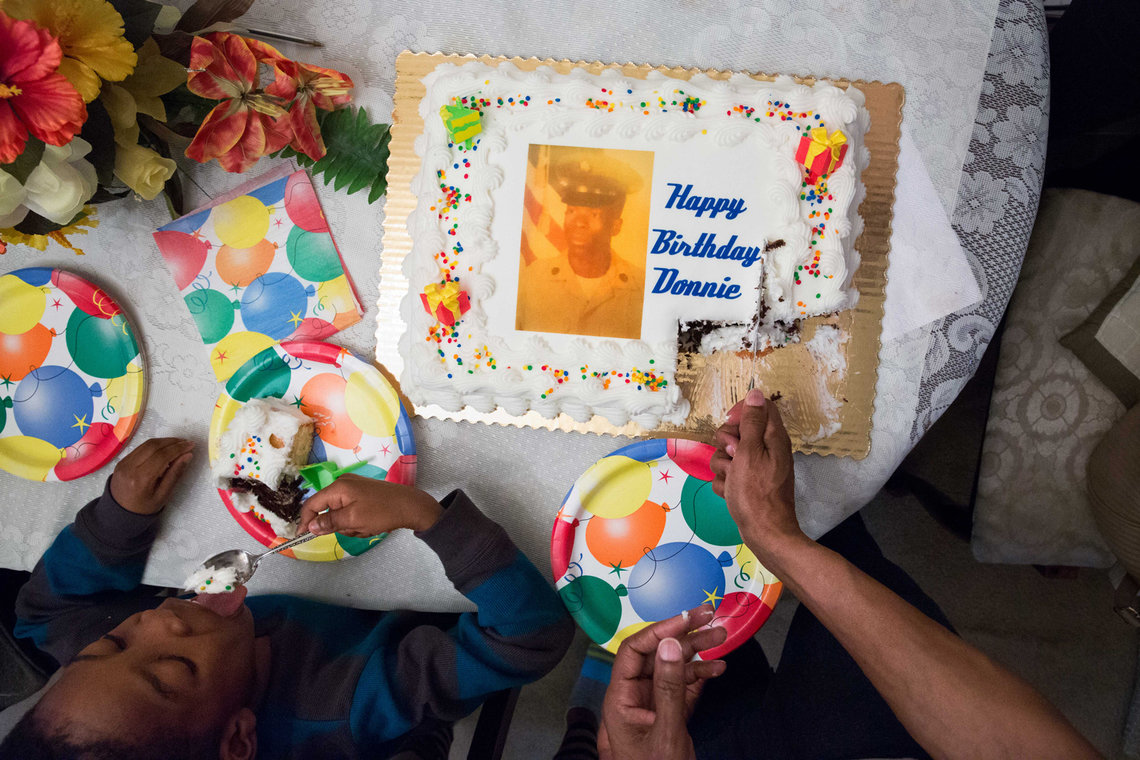 Elston cut into his 59th birthday cake, a few months after his release.
