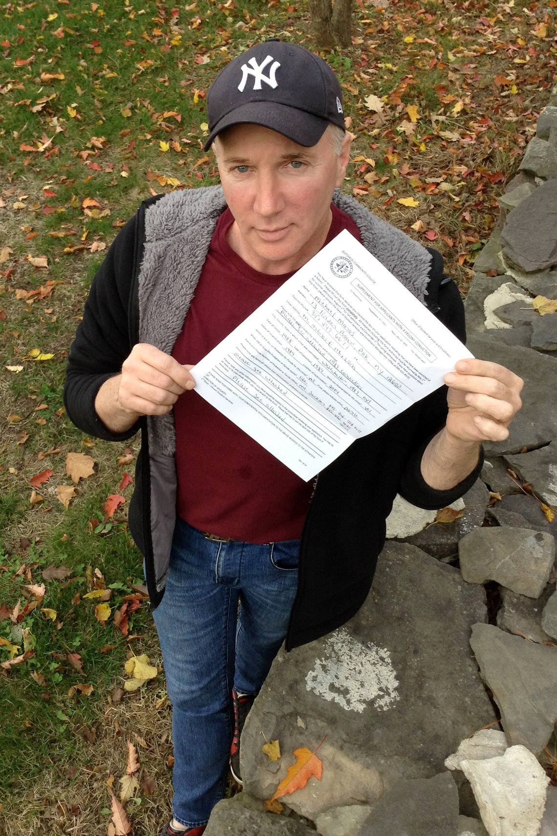 Michael Manos, an ex-felon and first-semester student at Dutchess County Community College, with paperwork given to applicants with a criminal history.