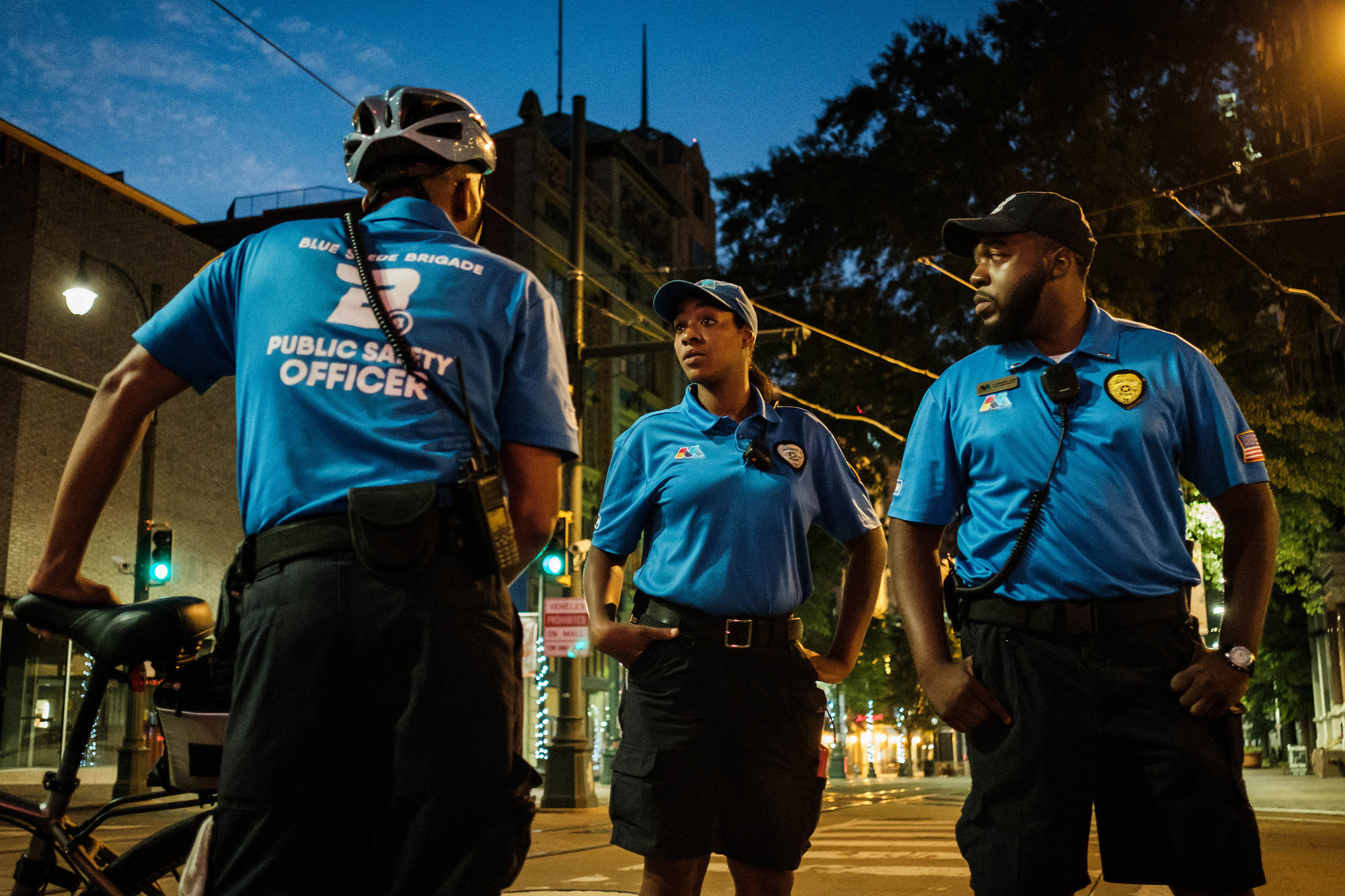 In response to a reduction in police officers in Memphis, Tenn., the Blue Suede Brigade, a private security force, patrols the city's tourist areas. From left, Blue Suede Brigade members Kcbena Cash, Tamala Johnson and Nathaniel Lewis worked the night shift.