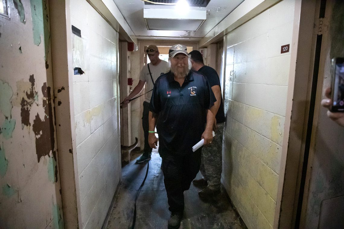 Kenneth Licklider, owner of Vohne Liche Kennels, walks through a hallway in one of the many training buildings at his facility, in Indiana, in September. Licklider, who founded the company in 1993 after retiring from the military, has been training canines for more than 40 years.