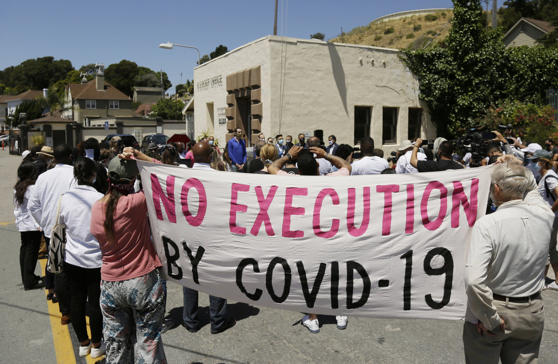 A group of legislators, advocates, academics and public health officials gathered outside San Quentin State Prison in California to discuss a COVID-19 outbreak at the facility in July.