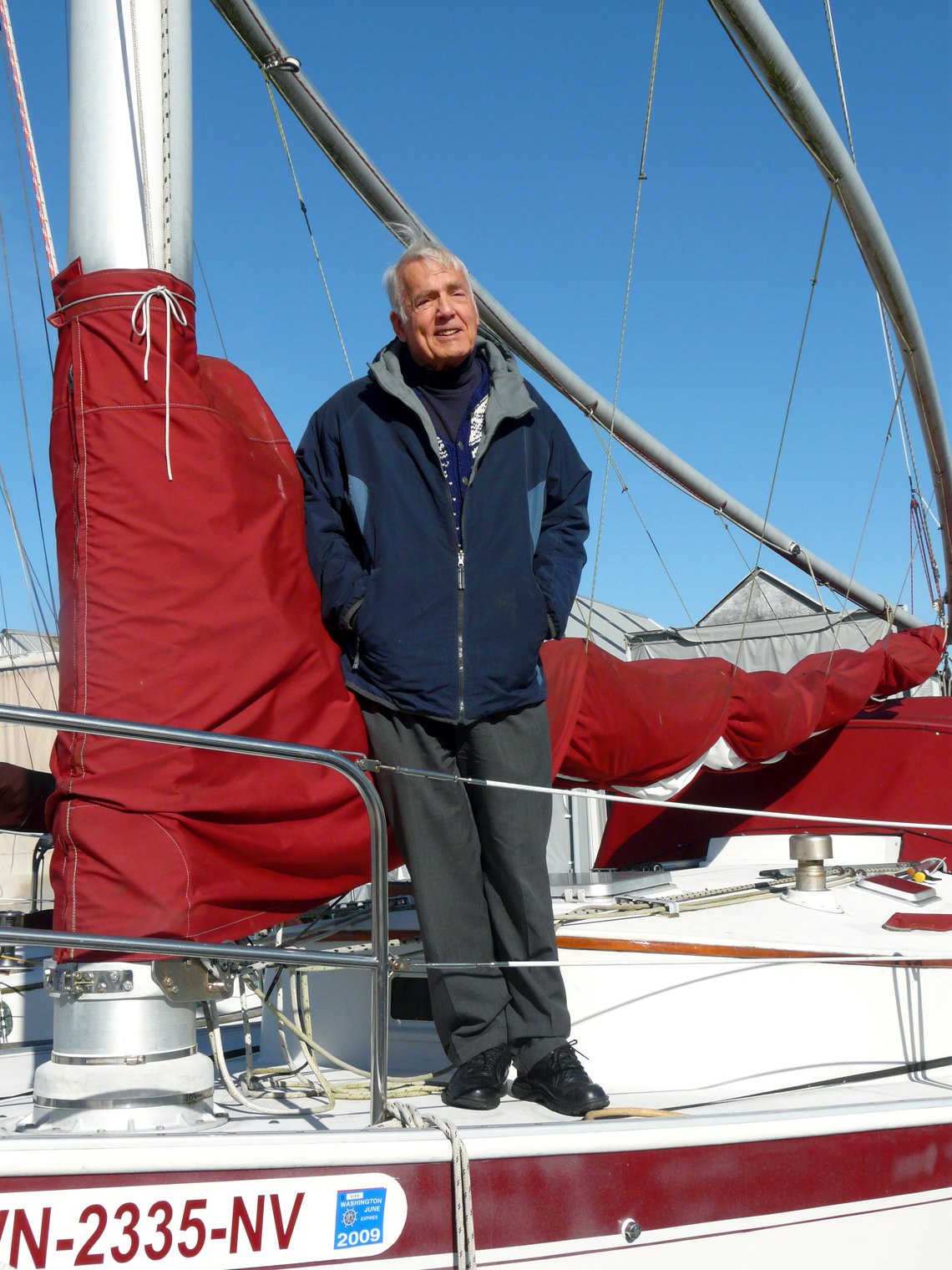 Justice Utter on his sailboat in an undated photo.