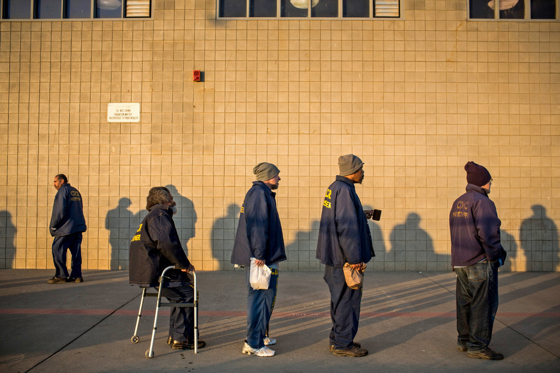 George Whitfield, sitting at left, waits to receive his daily blood pressure medicine at California State Prison, Solano, in Dec. 2013.