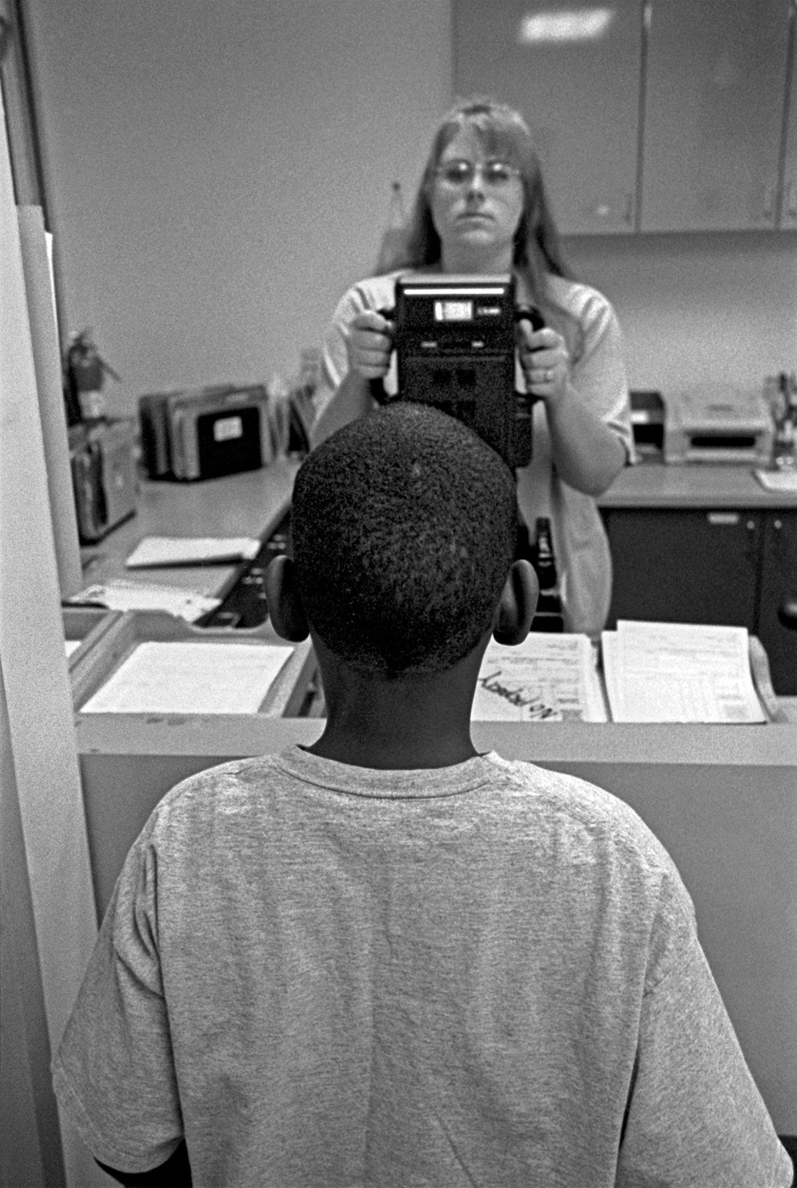 A 12-year-old boy photographed at the receiving department of Santa Clara Juvenile Hall. (San Jose, 1999)