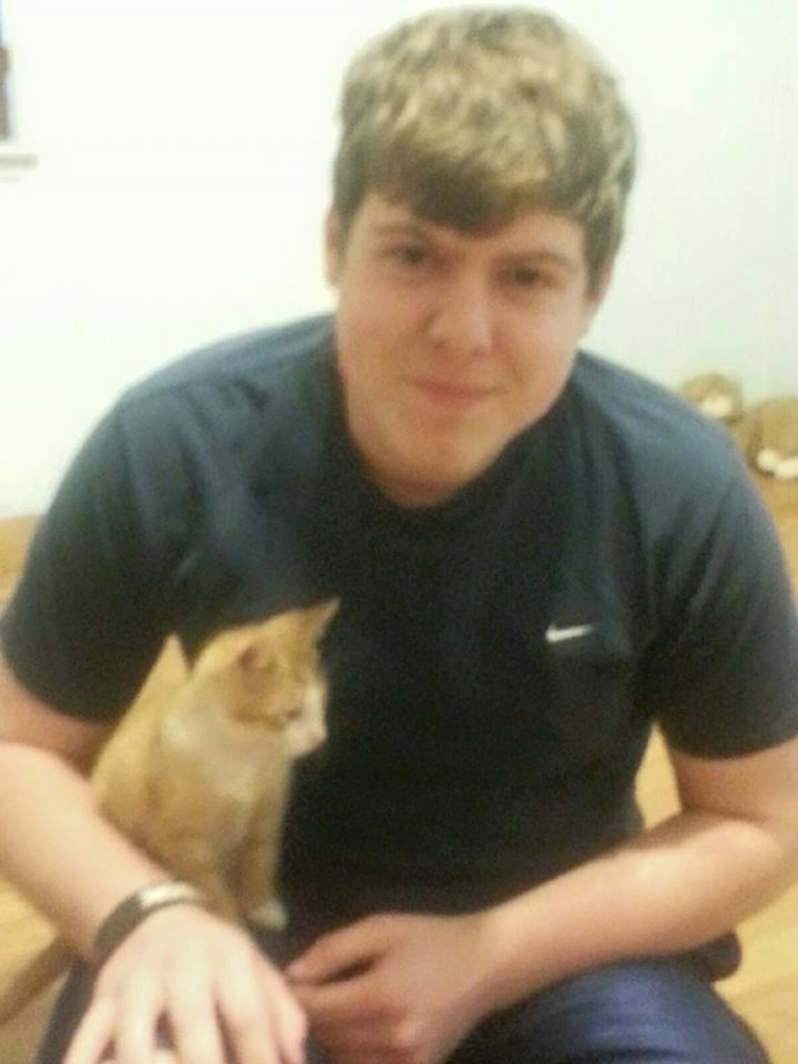 Zach Anderson and his new cat.