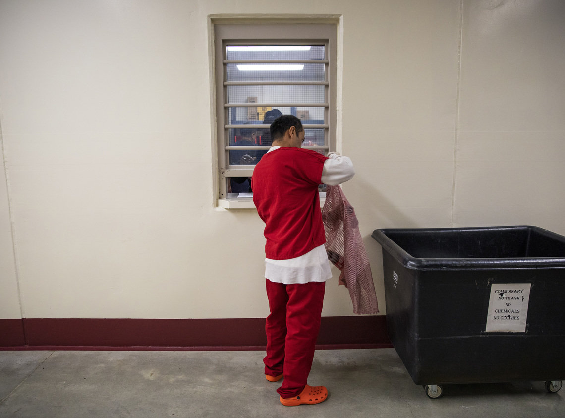 A detainee buys goods at the commissary at the Stewart Detention Center, which is run by CoreCivic, in Lumpkin, Ga., in 2019.