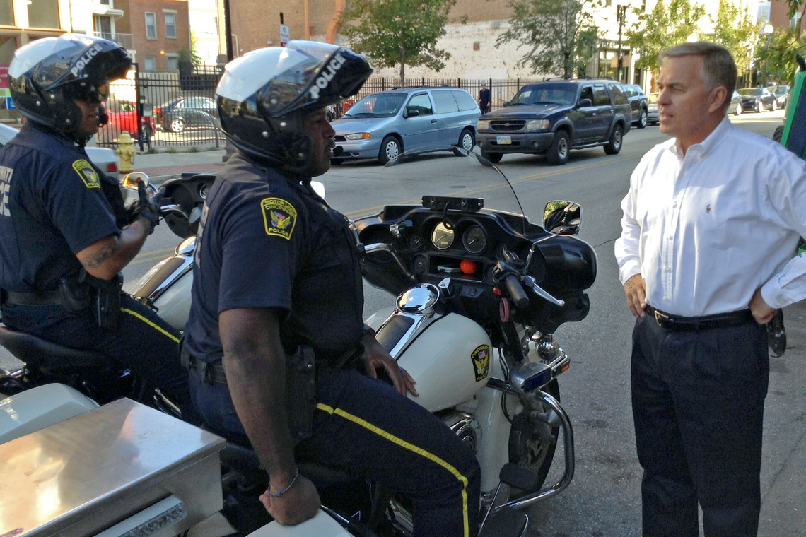 Former police chief Thomas Striecher talks with Cincinnati police officers in Over-the-Rhine.