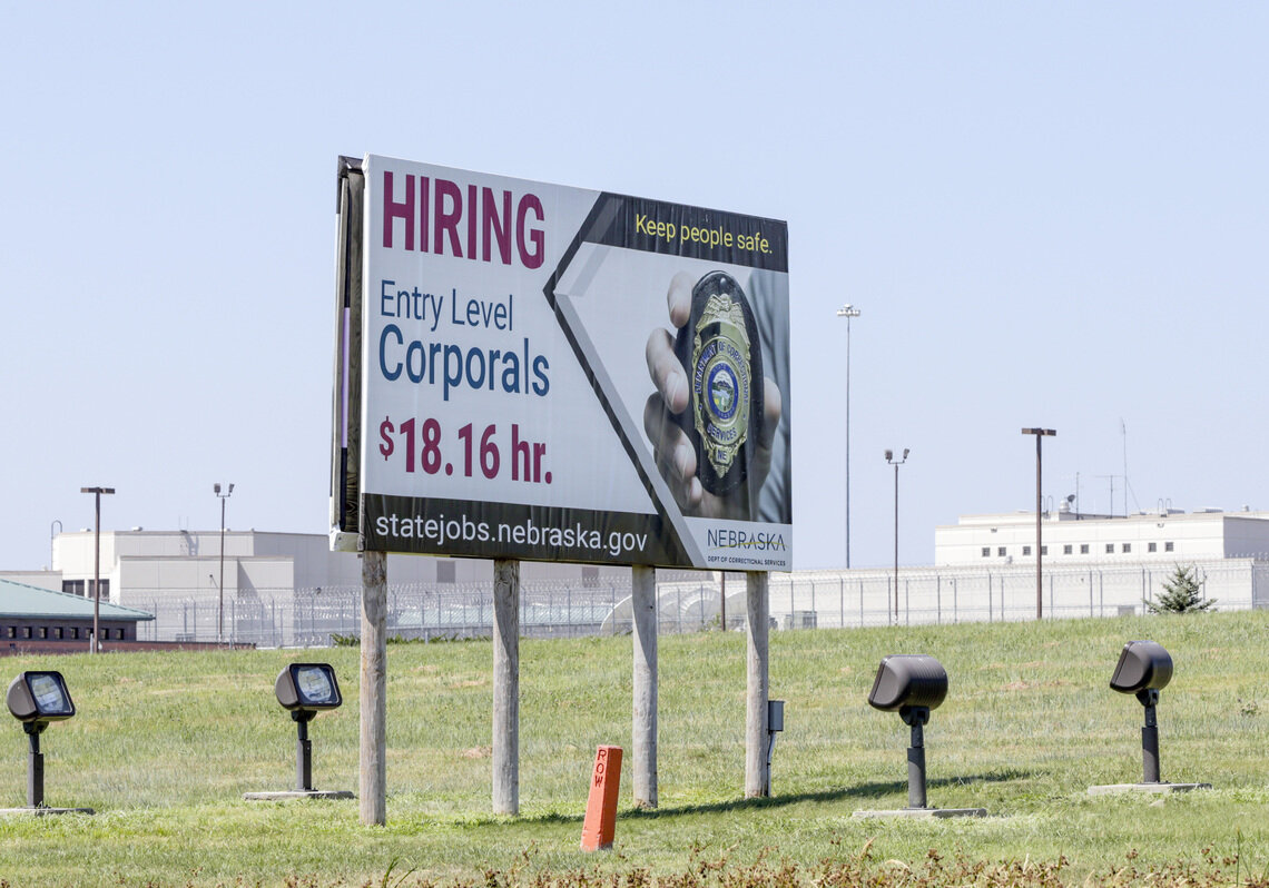 A billboard outside Nebraska's Tecumseh State Correctional Institution in 2018 advertised entry-level prison jobs.