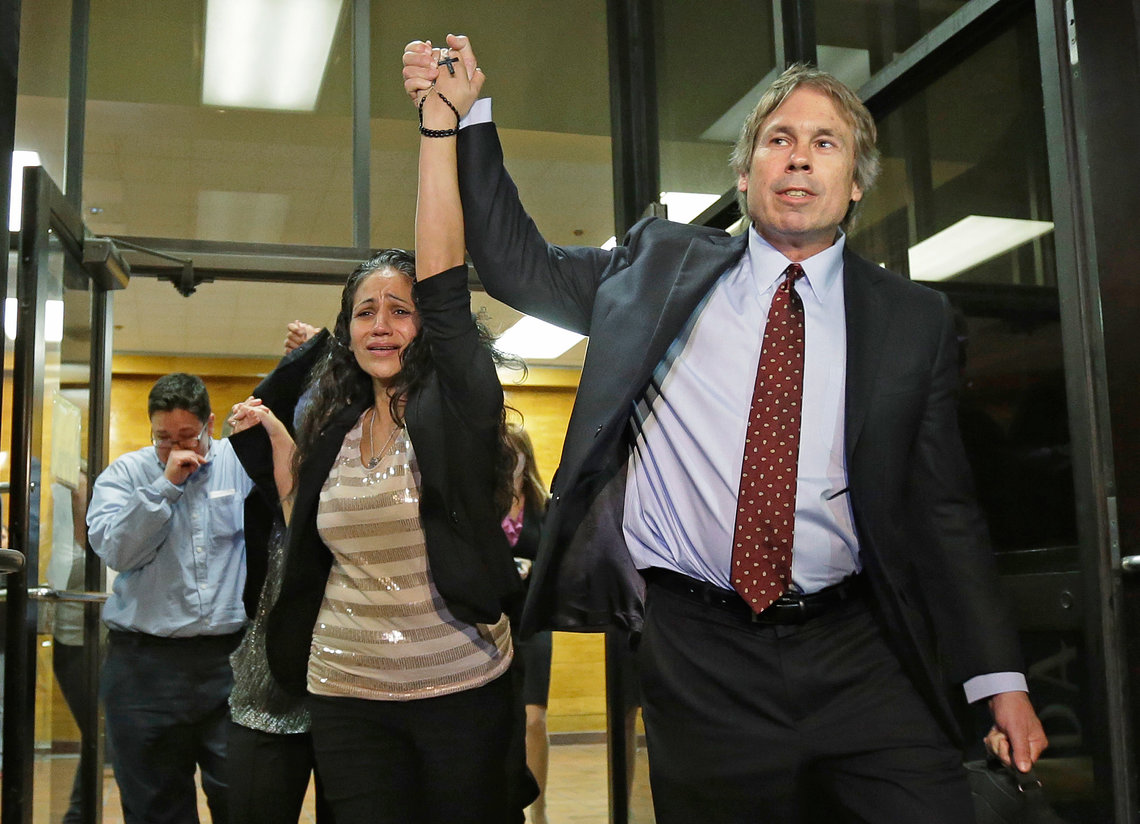 Cassandra Rivera, center, followed by Elizabeth Ramirez and Kristie Mayhugh, leave the Bexar County Jail with their attorney Mike Ware, right, on Monday, Nov. 18, 2013.