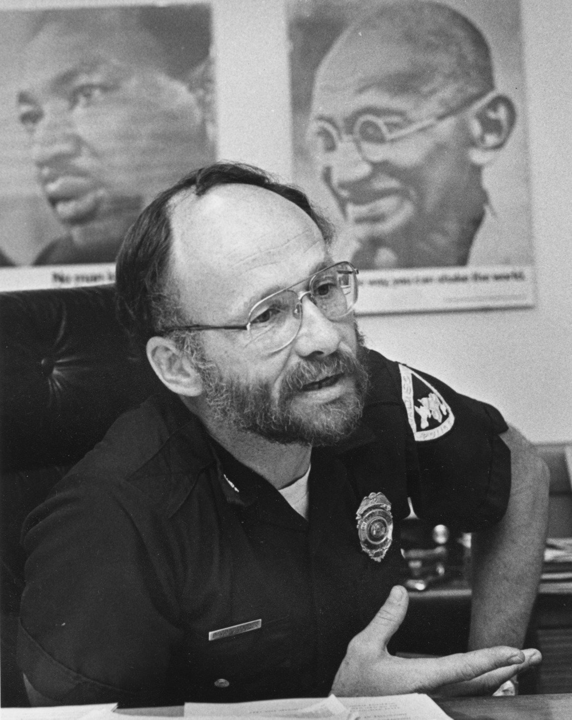 Former Madison Police Chief David Couper in his office with posters of Martin Luther King, Jr. and Mahatma Gandhi, in Wisconsin.
