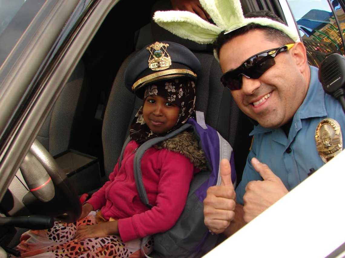 A member of the St. Paul Police Department during a police-sponsored Halal cookout.