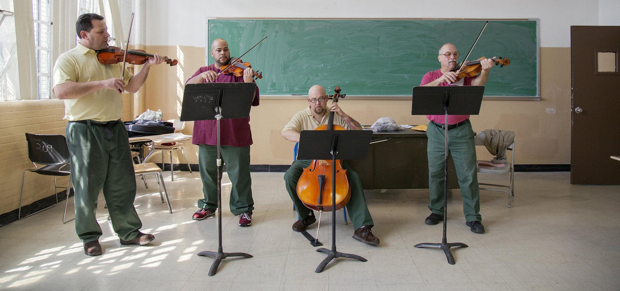 Jason Naradzay, far left, plays violin as part of the Riverside Quartet at Sing Sing Correctional Facility.