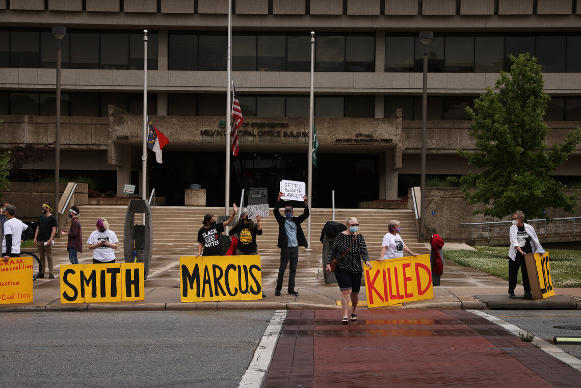 Demonstrators gather outside City Hall in Greensboro, N.C., on May 3, 2021 to protest the death of Marcus Smith after police hogtied him in September 2018.