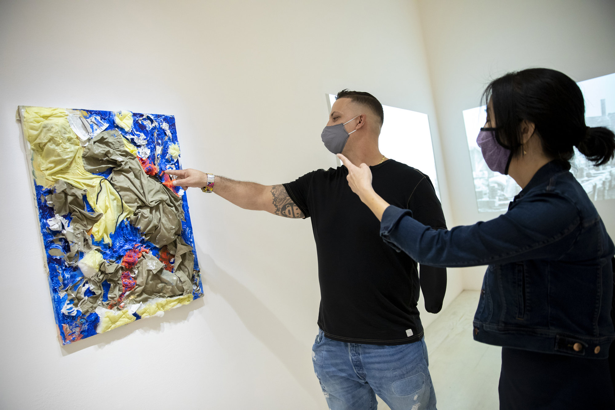 """At the MoMA PS1 exhibit """"Marking Time: Art in the Age of Mass Incarceration,"""" artist Gilberto Rivera shows Helena Huang of the Art for Justice Fund his 2012 work """"An Institutional Nightmare."""""""