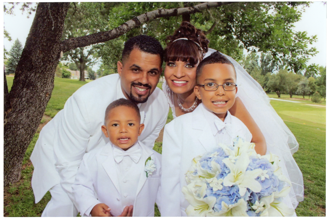 Rene and Jasmine on their wedding day in June 2013 with their son Josiah, left, and Jasmine's son Justus.
