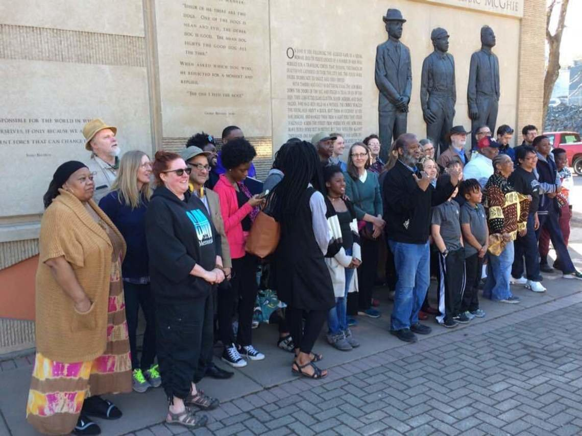 The Duluth, Minn. delegation to the National Memorial for Peace and Justice in Montgomery, Ala. gathers in front of the Clayton, Jackson, McGhie Memorial to that city's 1920 lynching before boarding a bus for a 1,223-mile journey to Alabama in April.