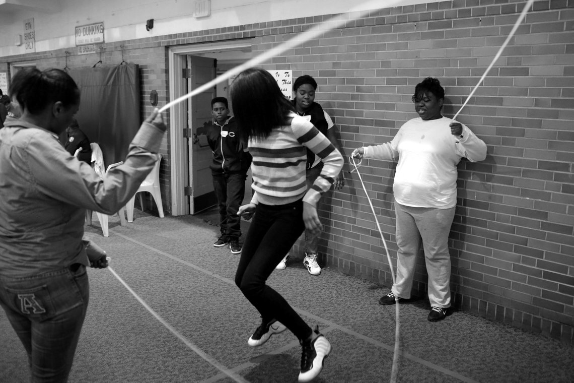 Tarza, right, turns the jump ropes as Jada skips Double Dutch.
