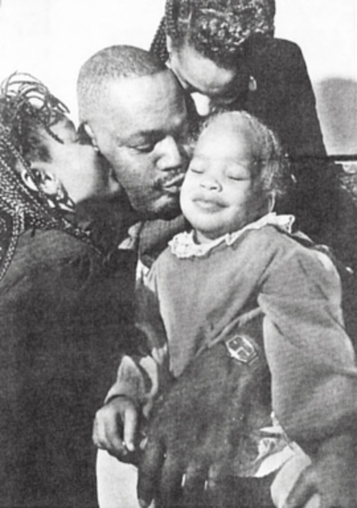 Phillip Chance embraces his family in a snapshot from the mid-1990s.