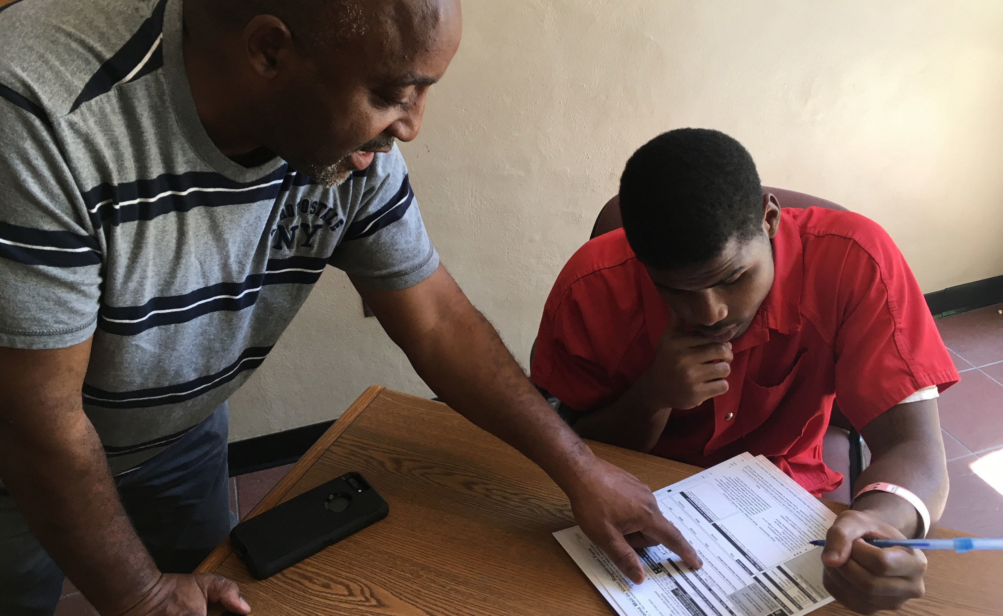 Pastor Kenneth Glasgow helps Spencer Trawick, an inmate at the Dothan City Jail in Dothan, Ala., fill out a voter registration form in June 2017.