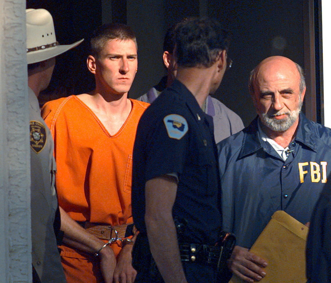 Timothy McVeigh being led out of the Noble County Courthouse in Perry, Okla. in 1995.   McVeigh was sentenced to death and executed in 2001.
