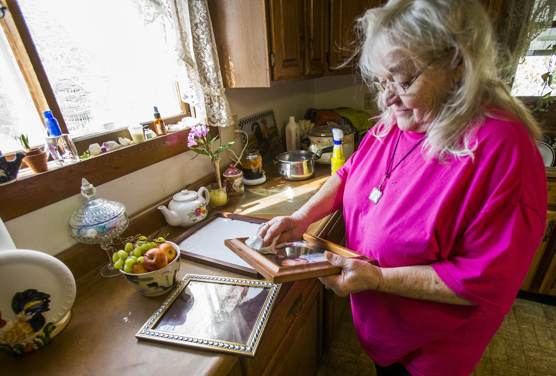 Alma Glisson looks at photos of her son, Nicholas Glisson, who died when at the Plainfield Correctional Facility in Plainfield, Ind.