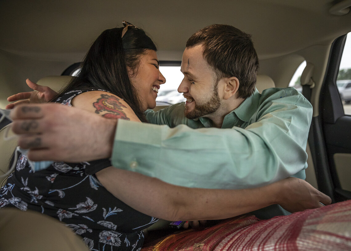 Trent Taylor enters a car and sees his fiancée, Maria Rios, for the first time as a free man after his release from prison.