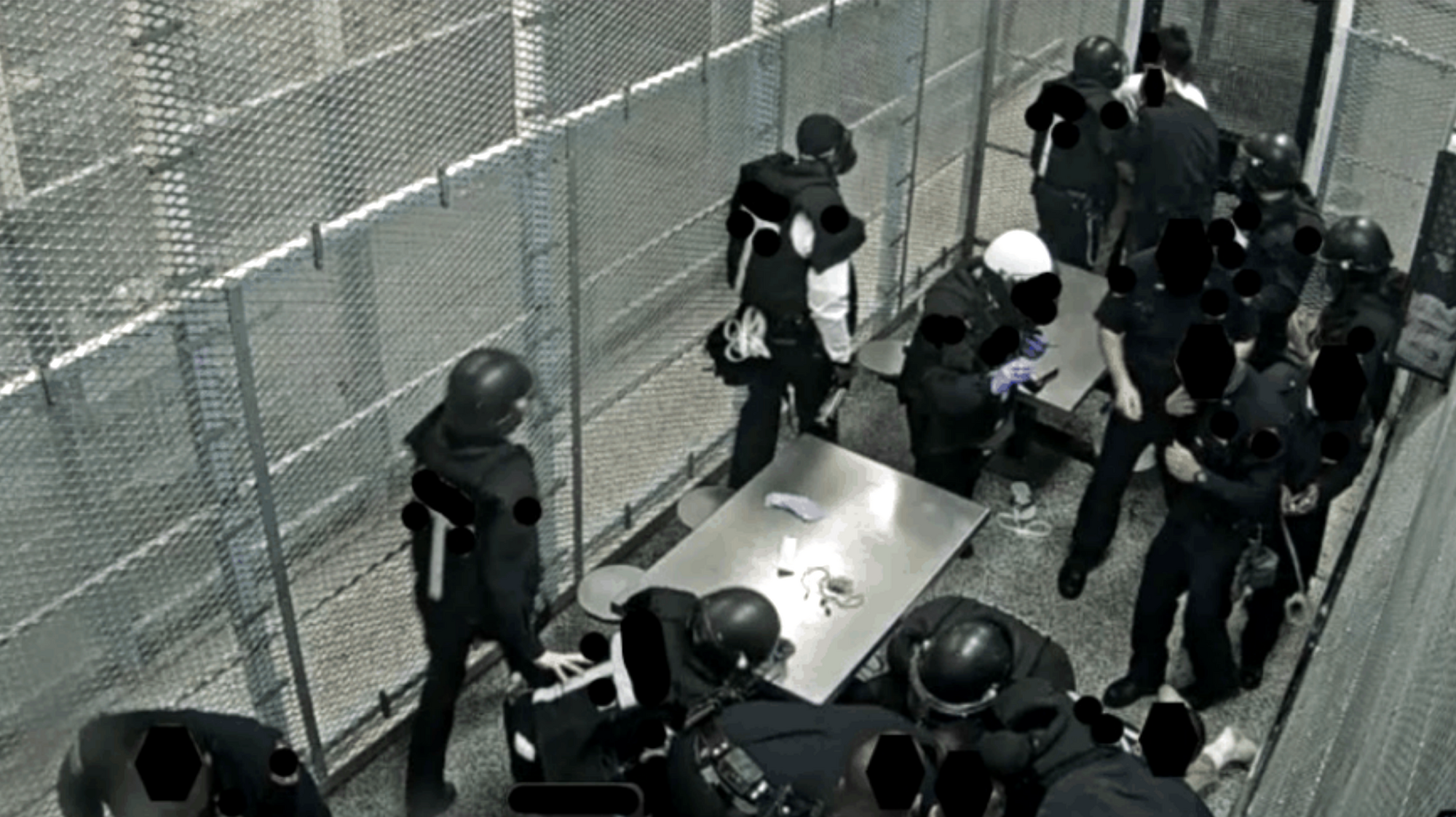 As part of the settlement of Nuñez v. City of New York, a 2011 class-action lawsuit filed by Rikers Island detainees, federal monitors periodically report on use of force across the jail complex. This image from the Eleventh Report shows at least 12 officers in a recreational area responding to two detainees who refused to be handcuffed.