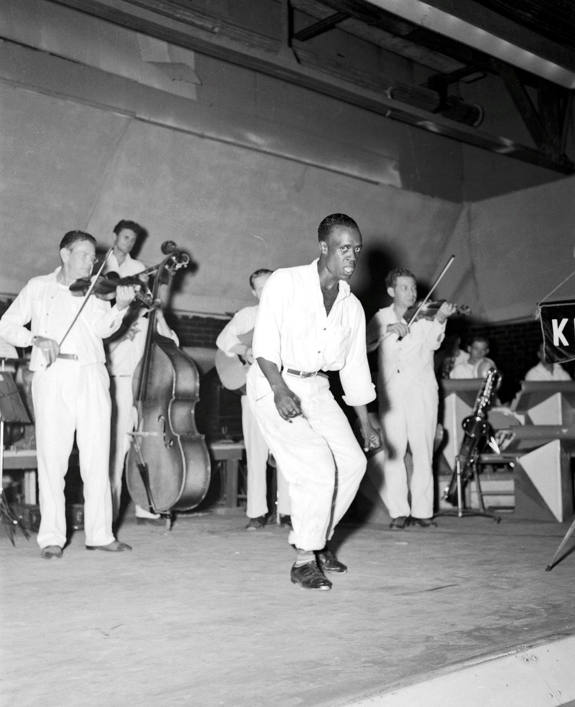 With the band urging him on, an inmate dances on KPRC's Thirty Minutes, circa 1950.