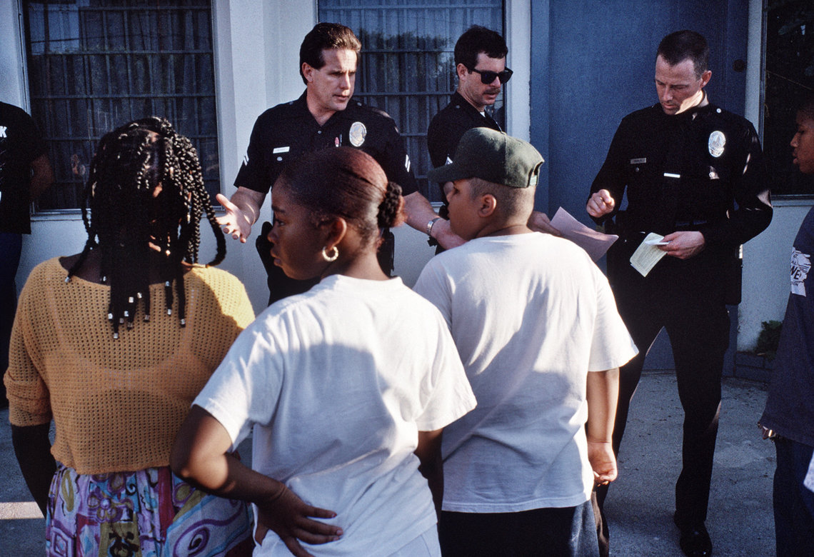 Los Angeles Police Department officers question people if they witnessed a shooting in September 1994.