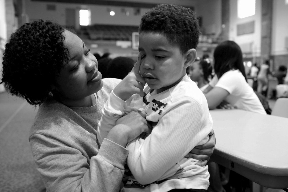 Lakeisha holds her son, Jayden, in the gymnasium at Logan Correctional Center.