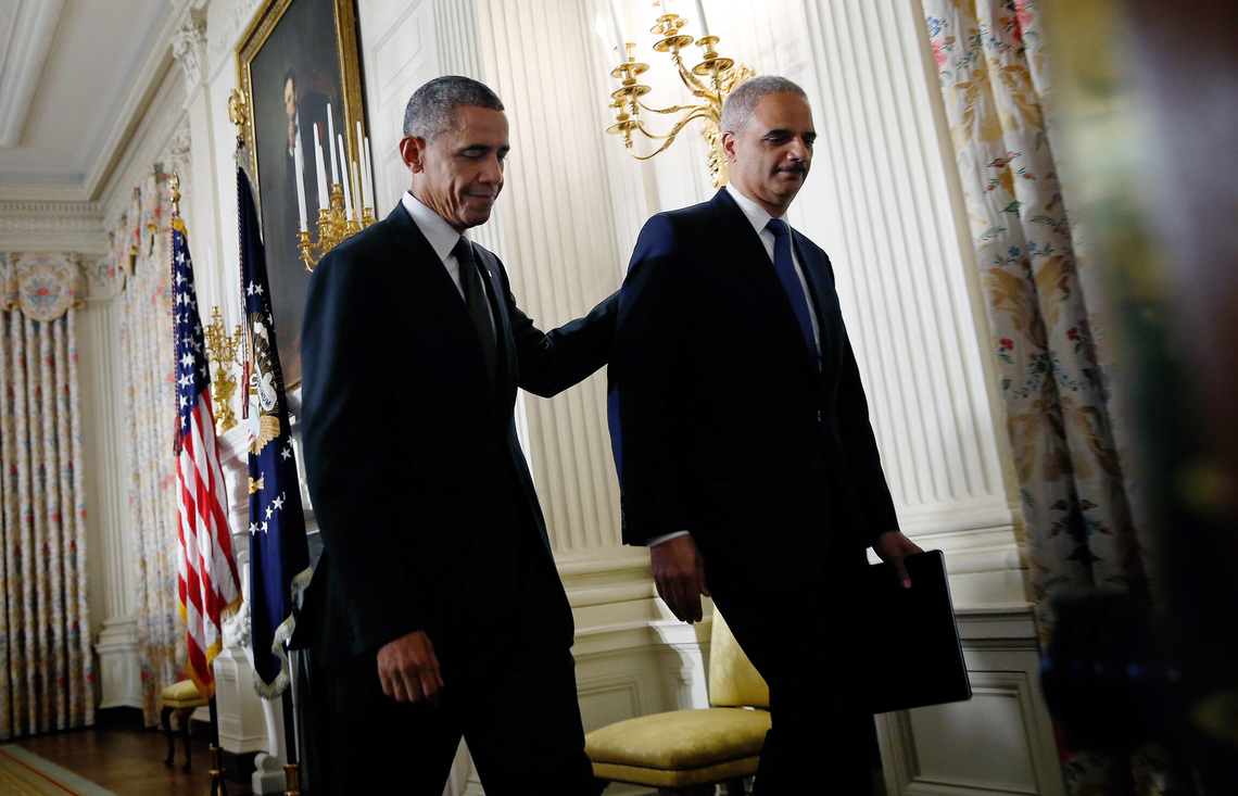 Holder with President Obama after announcing his resignation in September.